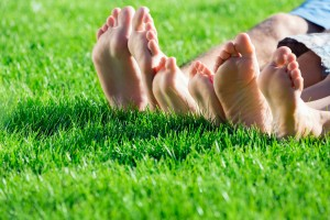Bare feet on a perfect lawn.